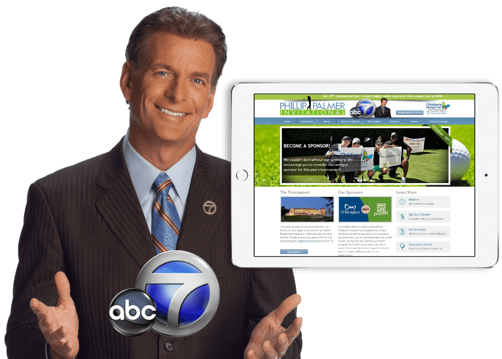 Phillip Palmer isolated on a transparent background holding the ABC 7 logo with a white ipad in the foreground showcasing his website.